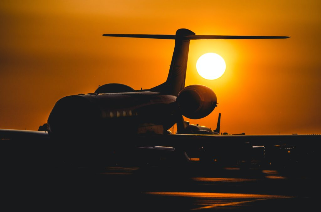 Grounded plane with sunset in the background